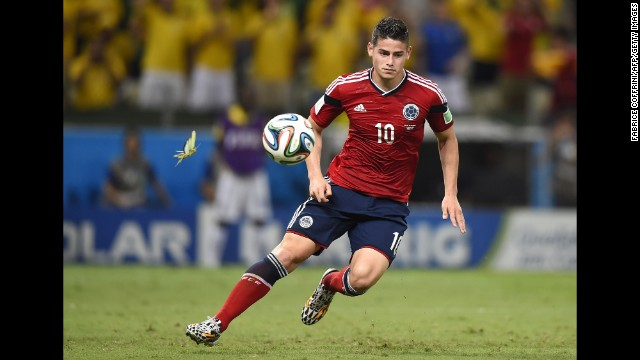 Colombia midfielder James Rodriguez runs with the ball.