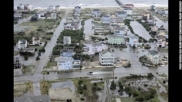 An aerial photo provided by the U.S. Coast Guard shows flooding caused by Hurricane Arthur on the Outer Banks of North Carolina on Friday, July 4. Arthur struck North Carolina as a Category 2 storm with winds of 100 mph late Thursday, taking about five hours to move across the far eastern part of the state.