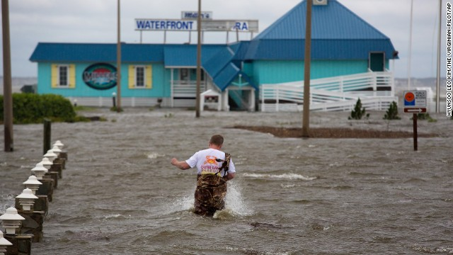 Bryan Wilson, owner of Miller's Waterfront restaurant, braves floodwaters to check the damage to his property as wind from Hurricane Arthur pushes water to his parking lot in Nags Head, North Carolina, on July 4.