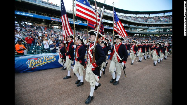 A fife and drum corps entertains the fans before the Detroit Tigers game against the Tampa Bay Rays at Comerica Park in Detroit.