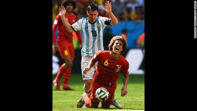 Argentina's Messi challenges Axel Witsel of Belgium.