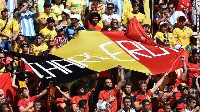 Belgium fans hold up a huge flag before the match against Argentina. <a href='http://www.cnn.com/2014/07/04/football/gallery/world-cup-0704/index.html'>See the best World Cup photos from July 4. </a>