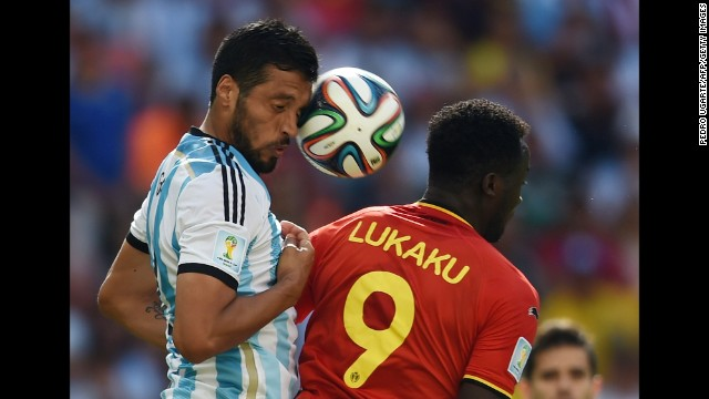 Argentina's defender Ezequiel Garay, left, vies with Belgium's forward Romelu Lukaku.