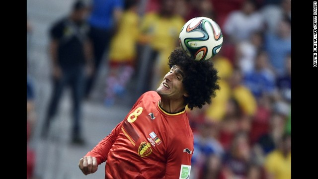 Belgium midfielder Marouane Fellaini heads the ball.