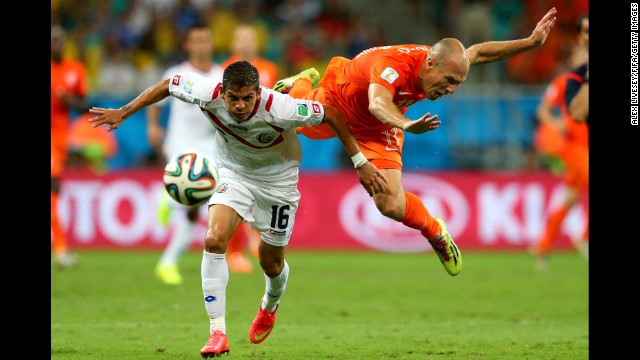 Cristian Gamboa of Costa Rica and Arjen Robben of the Netherlands compete for the ball.