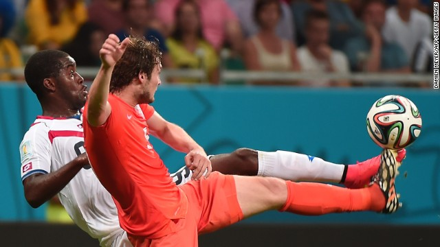 Costa Rica forward Joel Campbell, left, vies with Netherlands defender Daley Blind.