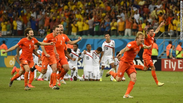 Netherlands team members celebrate after defeating Costa Rica during the penalty shootout after extra time in their quarterfinal football match on Saturday, July 5.