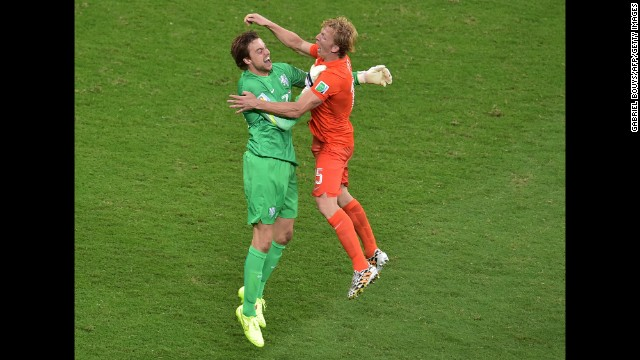 Netherlands' substitute goalkeeper Tim Krul, left, celebrates with defender Dirk Kuyt after the victory. Krul was the hero after saving two penalties to secure a 4-3 win in Salvador, Brazil.