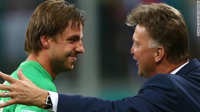 Dutch goalkeeper Tim Krul (left) is congratulated by his coach Louis van Gaal following his success in the penalty shootout against Costa Rica in the quarterfinals. Van Gaal sent on the Newcastle United keeper in the last minute of extra time.