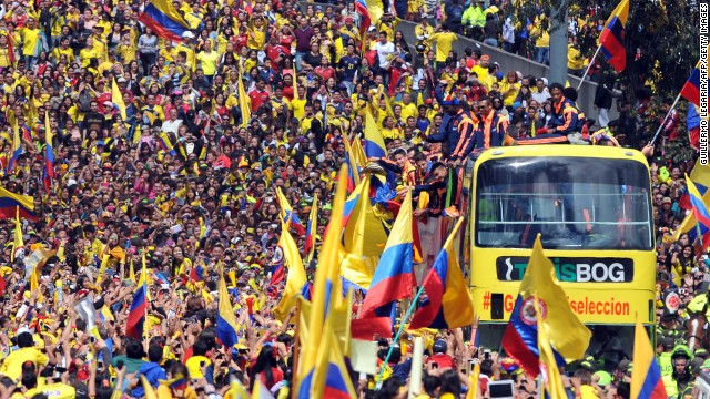 The Colombian team bus edges through massive crowds who greeted them in the capital Bogota.