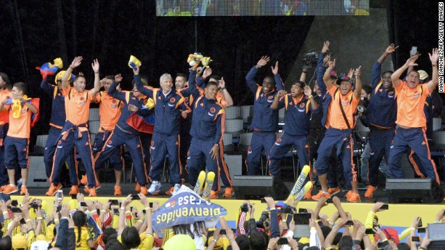 The Colombian squad shows off its dancing skills as it is paraded in front of its adoring fans.
