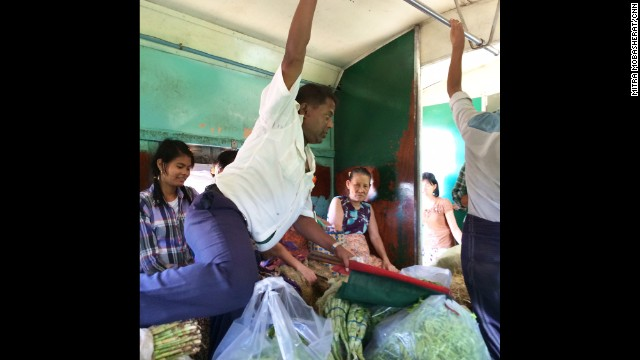 "YANGON, MYANMAR: ""Train conductor getting a workout, and having a meltdown, while trying to maneuver through stacks of vegetables on board the train around Yangon."" - CNN's Mitra Mobasherat. Follow Mitra (<a href='http://instagram.com/mitracnn' target='_blank'>@mitracnn</a>) and other CNNers along on Instagram at <a href='http://instagram.com/cnn' target='_blank'>instagram.com/cnn</a>."