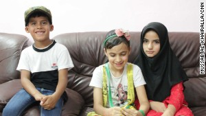 Six-year-old Ali, left, who lost his father in a bomb attack in Sadr City, sits alongside sister Baneen, center, 11, and Baneen\'s friend Hajer, 11, whose father was assassinated when she was only four years old.
