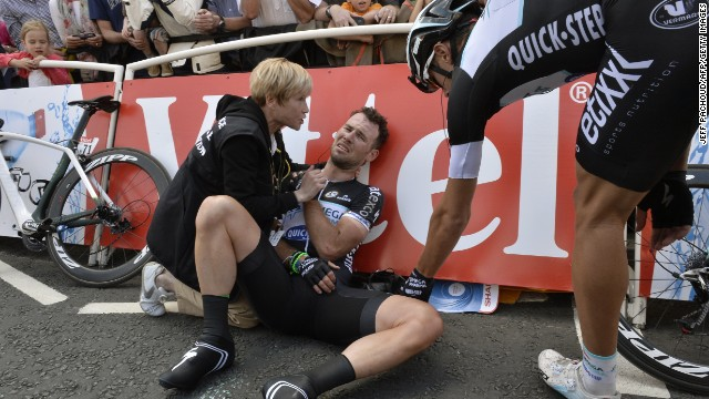 Cavendish had a Grand Depart to forget as he receives medical attention for a fall close to the finish line at the end of stage one.