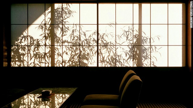 In a corner of the lobby, shoji doors back lit with shadows of swaying bamboo resemble a Japanese ink painting brought to life.