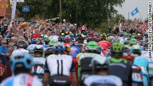 Tour de France stars get up close and personal with spectators on the opening stage in Yorkshire but they have complained about fans taking selfies and not paying attention to the risk they pose to the riders.