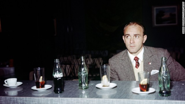 Di Stefano enjoys a beverage or two at a Madrid cafe in 1970.