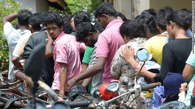Sri Lankan asylum seekers sent back by Australia outside the magistrate's court in Galle, July 8, 2014.