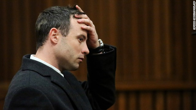 Oscar Pistorius sits in court in Pretoria, South Africa, on Tuesday, July 8. Pistorius, the first double amputee runner to compete in the Olympics, is accused of intentionally killing his girlfriend, Reeva Steenkamp, in February 2013. Pistorius has pleaded not guilty to murder and three weapons charges.