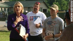 New York state Sen. Cathy Young presents Fit Nation\'s Mike Wilber with a citation as Major Patrick Miller stands by his side.