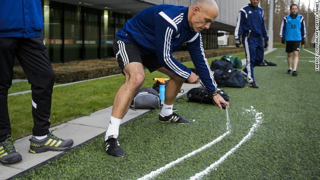 Here English referee Howard Webb tries the vanishing spray during a seminar for 2014 FIFA World Cup referees on March 27, 2014 at the home of FIFA in Zurich.