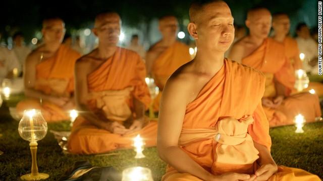 Buddhist monks meditate at Borobudur temple in Indonesia.