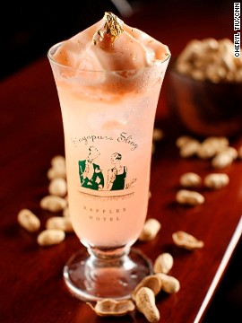 The Makati Sling, a pinkish version of the Singapore Sling, is a lime- and pineapple-juice concoction with Tanqueray Ten gin, cherry blossom, Grand Marnier and Benedictine with Angostura bitters whipped into foam and topped with 24k gold flakes ... and served in a Singapore Sling glass!