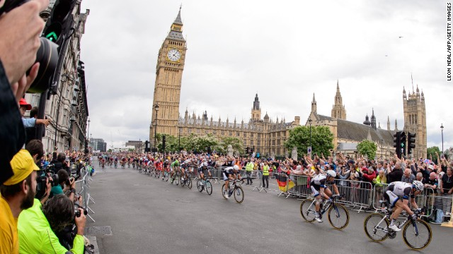 JULY 8 - LONDON, UK: Riders pass the Houses of Parliament near the finish of the 155 km stage of the 101st edition of the Tour de France cycling race. An estimated million people lined the <a href='http://edition.cnn.com/2014/07/04/sport/cycling-tour-de-france-yorkshire-wiggins/index.html'>narrow roads between Cambridge and London</a> to watch the near 200-strong peloton compete in the<a href='http://edition.cnn.com/2014/07/06/sport/cycling-cavendish-tour-de-france/index.html?hpt=isp_c2'> third stage of the Tour</a>.