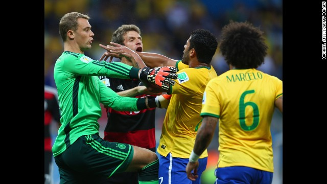 Neuer, left, separates Thomas Mueller of Germany and Hulk of Brazil.