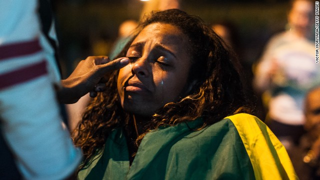 A fan wipes another fan's tears in the streets of Sao Paulo, Brazil.