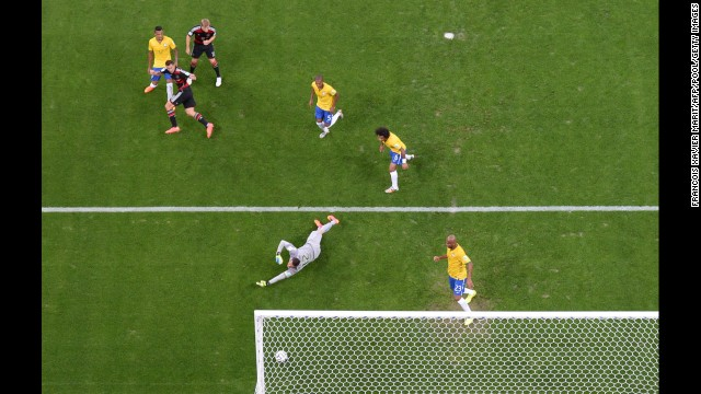 Germany's Miroslav Klose, second from left, scores his team's second goal. The goal also made Klose the all-time leading scorer in World Cup history.