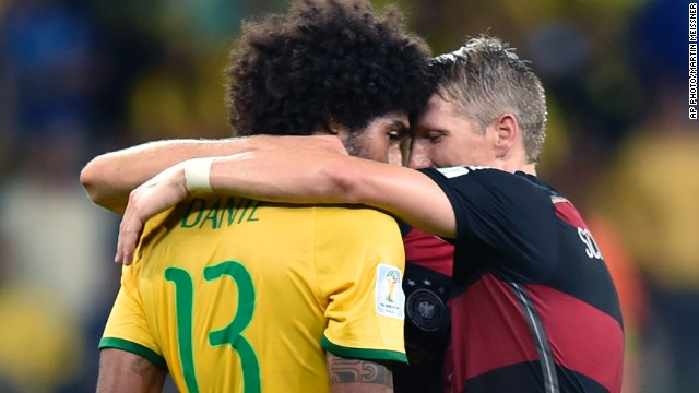 BELO HORIZONTE - JULY 9: Germany's Bastian Schweinsteiger consoles Brazil's Dante after Germany won the World Cup semifinal soccer match 7-1, <a href='http://edition.cnn.com/2014/07/08/sport/football/world-cup-brazil-germany-football/index.html?hpt=isp_c1'>breaking the hearts of millions of Brazilian fans</a>.