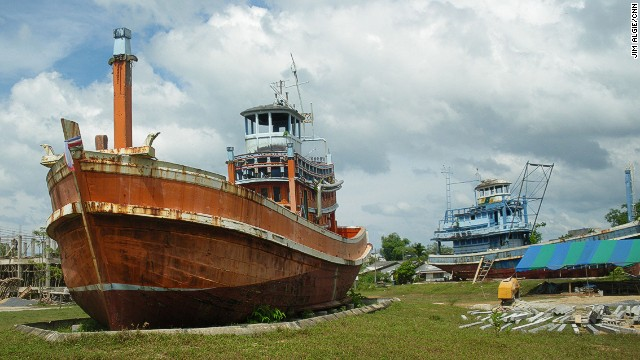 In the village of Ban Nam Khem, almost completely annihilated in the 2004 tsumani, two fishing trawlers have been left in an empty lot a kilometer inland to commemorate the 6,000 victims in Thailand.