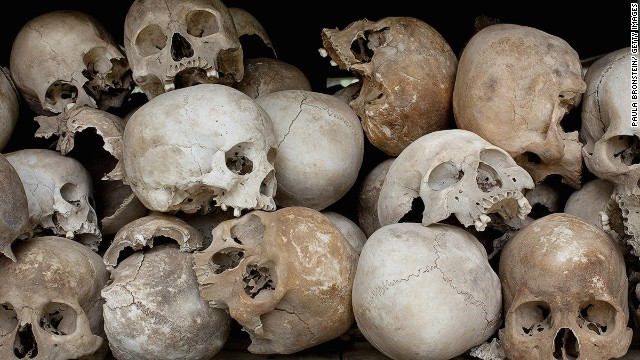 Some of the 8,000 human skulls at the Choeung Ek Genocidal Center in Cambodia sit in a glass case.