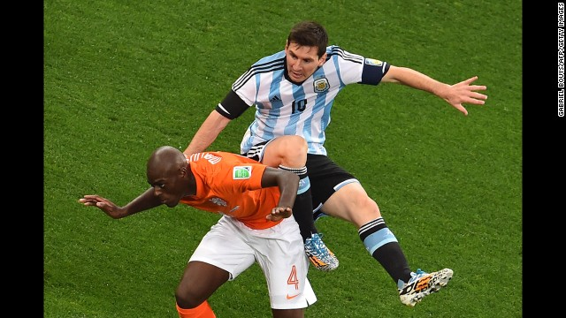 Dutch defender Bruno Martins Indi, left, collides with Messi in the first half.