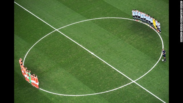 Before the match, the two teams observe a moment of silence for Alfredo Di Stefano, the soccer legend who passed away this week at the age of 88.
