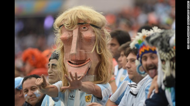 An Argentina fan in the stadium wears a mask of former player Claudio Caniggia.