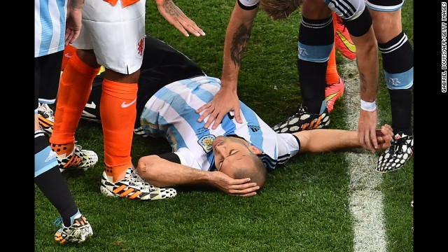 Argentina midfielder Javier Mascherano receives medical assistance. His head collided with an opponent's in the first half, but he kept playing.