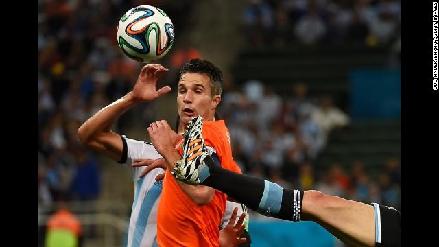 Dutch striker Robin van Persie is surrounded by Argentine defenders.