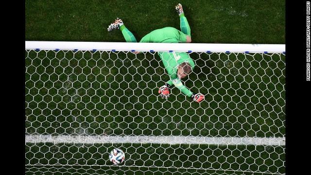 Dutch goalkeeper Jasper Cillessen fails to stop a ball during the penalty shoot-out.
