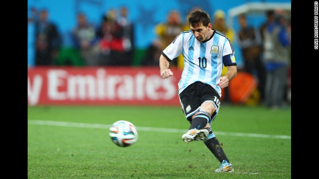 Argentina captain Lionel Messi shoots and scores a goal in a penalty shootout.