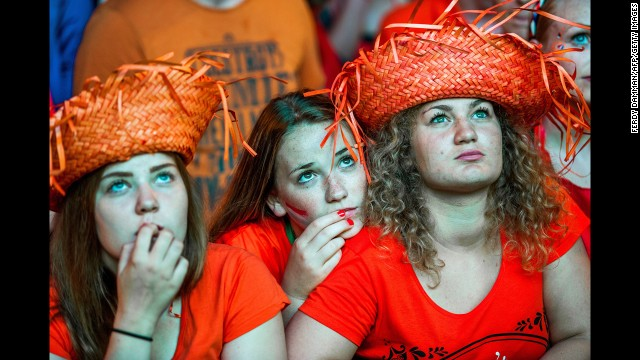 The market square in Groningen, Netherlands, is filled with supporters of the Dutch national football team. Despite the rain, 4,500 people gathered to watch the World Cup semifinal match between the Netherlands and Argentina.