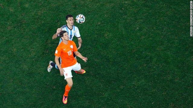 Klaas-Jan Huntelaar of the Netherlands controls the ball against Martin Demichelis of Argentina.
