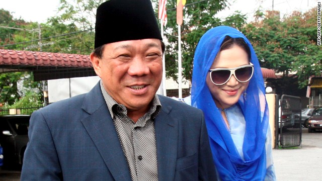 This photo taken on May 19, 2010 shows Malaysian lawmaker Bung Mokhtar Radin, at left, and his wife Zizie Ezette.