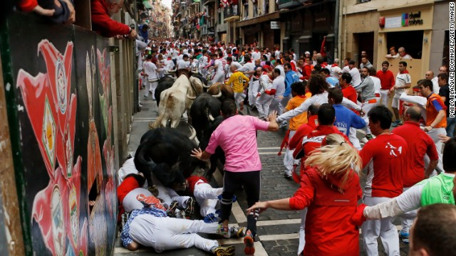Bulls run over revelers on Thursday, July 10.