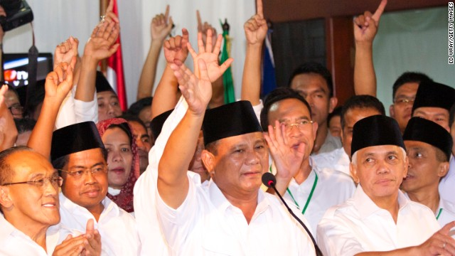 Indonesian presidential candidate Prabowo Subianto greets supporters as the vote count continues.