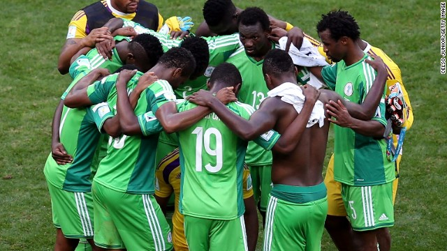 Nigeria's players form a huddle after a 2-0 defeat to France sent the African champions packing from Brazil 2014.