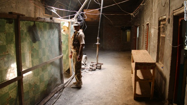 A soldier inspects the inside of a compound in Miranshah, which the army believes was used by militant fighters.