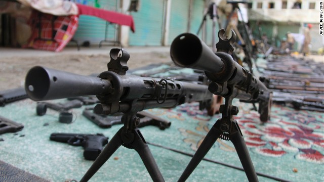 The military put a staggering array of captured weapons, such as these heavy machine guns, on display in the center of Miranshah.