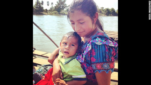 "GUATEMALA: ""A mother and child wait to cross from Guatemala into Mexico. Their hope is to make it to the U.S."" - CNN's Ismael Estrada, July 9. For some Guatemalan immigrants, the start of their journey to the U.S. begins with a dangerous ride on a zip line or a raft. They are risking their lives to escape their home country and cross the border into Mexico. CNN's Gary Tuchman got a first hand look when he visited a remote area of the Suchiate River along the Guatemala-Mexico border. <a href='http://ac360.blogs.cnn.com/2014/07/09/guatemalans-begin-their-journey-to-the-u-s-by-risking-their-lives/?iref=allsearch'>FULL STORY AT CNN.COM</a>. Follow Ismael (<a href='http://instagram.com/ishestradacnn' target='_blank'>@ishestradacnn</a>) and other CNNers along on Instagram at <a href='http://instagram.com/cnn' target='_blank'>instagram.com/cnn</a>."